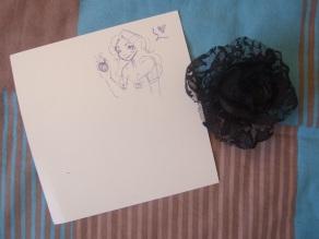 Pour commencer, la carte (avec un petit mot derrière) et une très jolie rose à mettre dans les cheveux